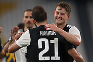 Juventus's Argentinian striker Gonzalo Higuain celebrates with Dutch defender Matthijs De Ligt after scoring to give the side a 3-0 lead during the Serie A match at Allianz Stadium, Turin. Picture date: 26th June 2020. Picture credit should read: Jonathan Moscrop/Sportimage