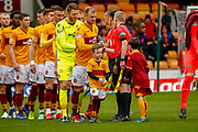 Motherwell Players shaking hands with the match officials  ahead of the Ladbrokes Scottish Premiership match between Motherwell and Heart of Midlothian at Fir Park, Motherwell, Scotland on 17 February 2019.