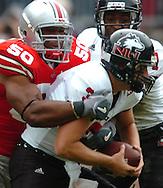 MORNING JOURNAL/DAVID RICHARD.Defensive end Vernon Gholston, left, of Ohio State sacks Northern Illinois quarterback Phil Horvath yesterday in Columbus.