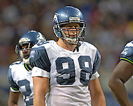 Seattle defensive end Grant Wistrom (98) during game action against St. Louis at the Edward Jones Dome in St. Louis, Missouri, October 9, 2005.  The Seahawks beat the Rams 37-31.