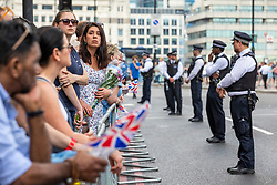 © Licensed to London News Pictures. 03/06/2018. London, UK. Members of the public gather at London Bridge to lay flowers and observe a minute's silence to mark the first anniversary of the London Bridge and Borough Market terror attack. Photo credit: Rob Pinney/LNP
