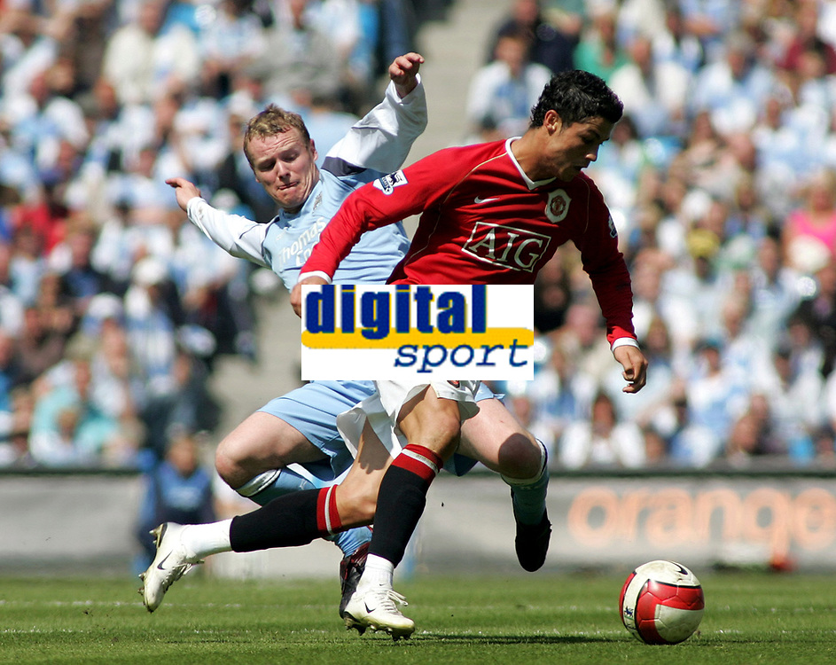 Photo: Paul Thomas.<br /> Manchester City v Manchester United. The Barclays Premiership. 05/05/2007.<br /> <br /> Michael Ball (L) of City tries to tackle Cristiano Ronaldo.