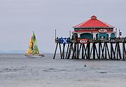 Sailing by Huntington Beach Pier