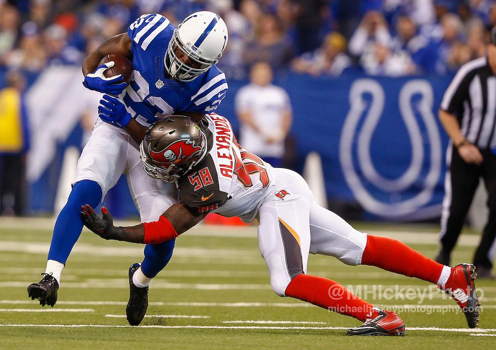 INDIANAPOLIS, IN - NOVEMBER 29 : Frank Gore #23 of the Indianapolis Colts is tackled by Kwon Alexander #58 of the Tampa Bay Buccaneers at Lucas Oil Stadium on November 29, 2015 in Indianapolis, Indiana. (Photo by Michael Hickey/Getty Images) *** Local Caption *** Frank Gore; Kwon Alexander
