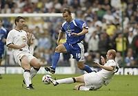 Photo: Aidan Ellis.<br /> Leeds United v Cardiff City. Coca Cola Championship. 19/08/2006.<br /> Cardiff's Ricardo Scimeca gets in between Leeds Paul Butler and Stephen Crainey