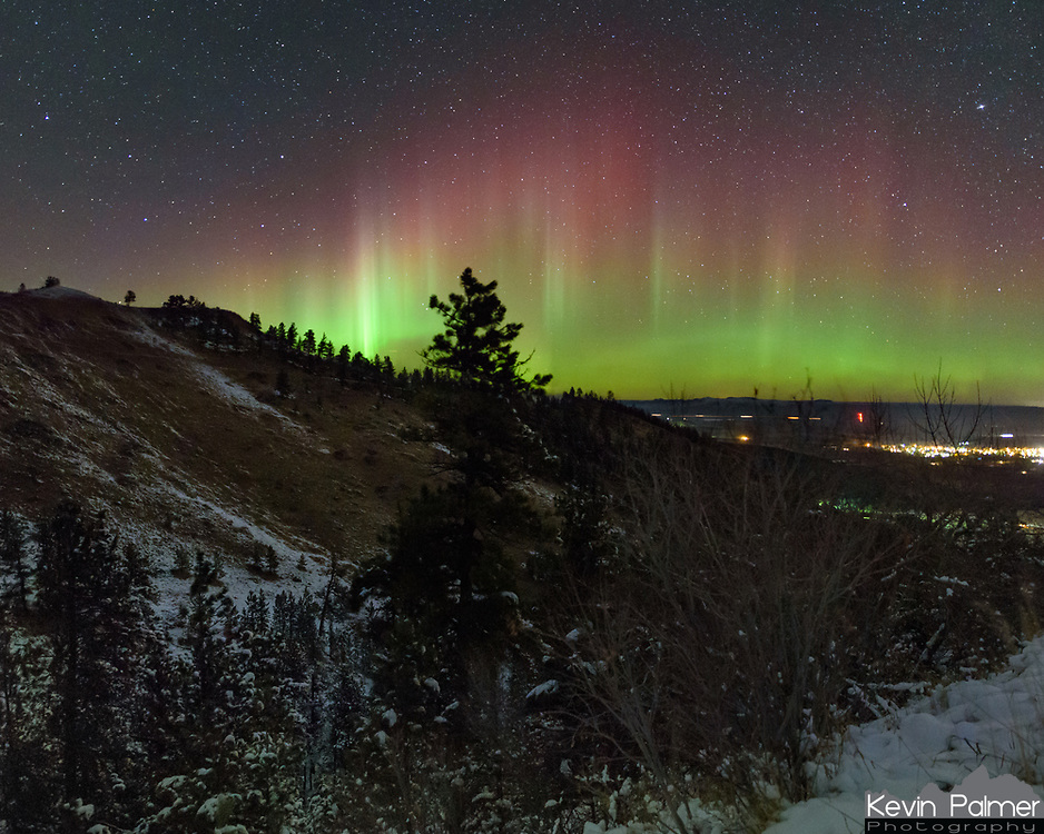 The aurora borealis caused red and green pillars to fill the northern sky above the Bighorn Mountains.