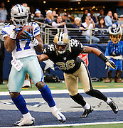 Dallas Cowboys wide receiver Dwayne Harris (17) catches a pass in the end zone for a touchdown against the New Orleans Saints at Cowboys Stadium in Arlington, Texas, on December 23, 2012.  (Stan Olszewski/The Dallas Morning News)