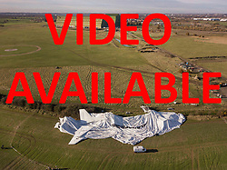 VIDEO AVAILABLE AT  http://tinyurl.com/ydcoah8j   © Licensed to London News Pictures. 19/11/2017. Bedford, UK. The remains of the Airlander 10 airship are seen in a field near Cardington air sheds. The world's longest aircraft has collapsed to the ground after breaking free from it's mooring.  A safety mechanism deflated the aircraft automatically. Two people on the ground suffered minor injuries.Photo credit: Peter Macdiarmid/LNP