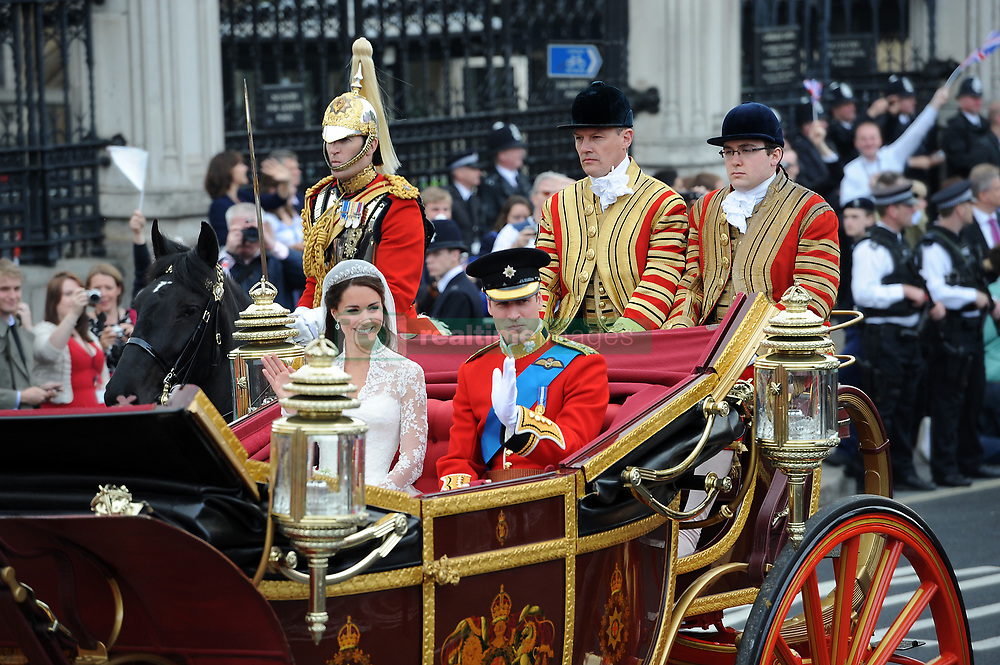 Prince William and his bride Kate leave Westminster Abbey in London as man and wife after their wedding