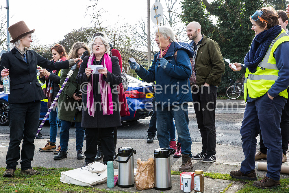 Windsor, UK. 22nd February, 2019. Singers entertain around 60 campaigners from Reclaim the Power and Fuel Poverty Action who set up a mock fracking site during a family-friendly protest outside the headquarters of Centrica to call on the British multinational energy and services company to cease its support for fracking operations through its partnership with shale gas company Cuadrilla Resources.