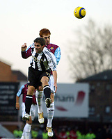Photo: Chris Ratcliffe.<br />West Ham United v Newcastle United. The Barclays Premiership. 17/12/2005.<br />Micheal Owen (L) of Newcastle and James Collins go up for a header.