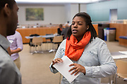 Purchase, NY – 31 October 2014. Port Chester High School student Ziyah House conferring with Morgan Stanley facilitator Michael Cox. The Business Skills Olympics was founded by the African American Men of Westchester, is sponsored and facilitated by Morgan Stanley, and is open to high school teams in Westchester County.