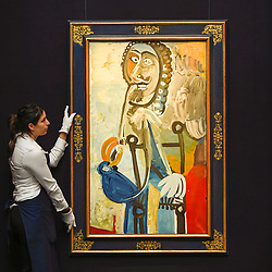 """© Licensed to London News Pictures. 14/06/2019. LONDON, UK.  A technician presents """"Homme à la pipe"""", 1968, by Pablo Picasso (Est. £5.5-7.5m). Preview of Impressionist and Modern art sales, which will take place at Sotheby's New Bond Street on 18 and 19 June 2019. Photo credit: Stephen Chung/LNP"""