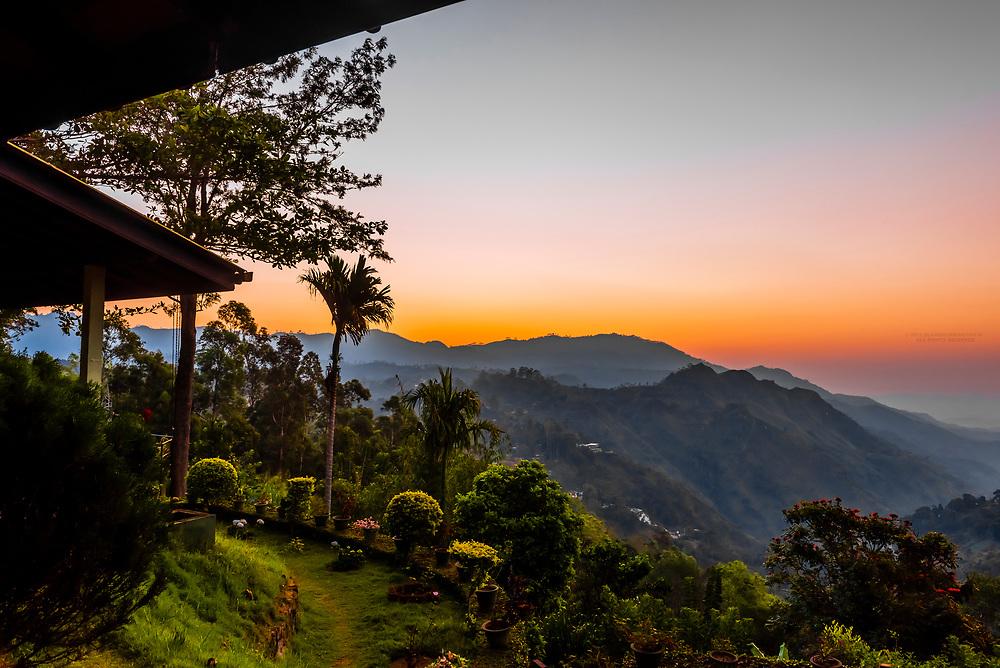 Sunrise,  Ella Rock and the Ella Gap from the Ambiente Guest House, Ella, Uva Province, Sri Lanaka.