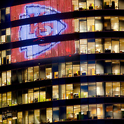 Kansas City Chiefs logo emblazoned on the LED display along the H&R Block World Headquarters highrise in downtown Kansas City, Missouri