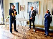 DEN HAAG, 26-06-2021 ,Koninklijke Schouwburg <br /> <br /> Koning Willen Alexander en minister-president Rutte zijn aanwezig bij de Nederlandse Veteranendag, het jaarlijkse eerbetoon aan alle Nederlandse veteranen. Dit jaar vindt de viering plaats in de Koninklijke Schouwburg in Den Haag, waar vier veteranen hun bijzondere verhalen vertellen. De minister-president, minister Bijleveld van Defensie en de voorzitter van het Nationaal Comité Veteranendag houden een toespraak. ultaten zien van hun tijdelijk verblijf aan de Rijksakademie. <br /> FOTO: Brunopress/Patrick van Emst