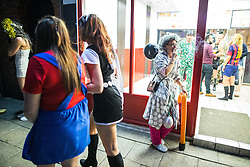 © Licensed to London News Pictures . 27/12/2016 . Wigan , UK . Revellers in Wigan enjoy Boxing Day drinks and clubbing in Wigan Wallgate . In recent years a tradition has been established in which people go out wearing fancy-dress costumes on Boxing Day night . Photo credit : Joel Goodman/LNP