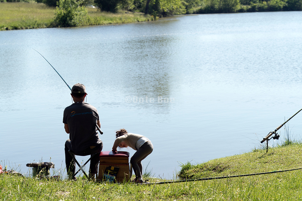 father with little child enjoying a recreational fishing day together