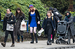 © Licensed to London News Pictures. 13/04/2018. London, UK. Transgender activist TARA WOLF (blue dress) is joined by campaigners as she arrives at Hendon Magistrates' Court in London where she is currently on trial for assaulting radical feminist Maria Maclachlan. Tara Wolf, 26, is accused of assault by beating on Maria MacLachlan, 61, during a demonstration at Speaker's Corner, Hyde Park on September 13, last year. Photo credit: Ben Cawthra/LNP