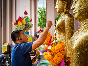 10 JULY 2018 - NAKHON PATHOM, THAILAND: A man makes merit at Phra Pathom Chedi in Nakhon Pathom. Nakhon Pathom is about 35 miles west of Bangkok. It is one of the oldest cities in Thailand, archeological evidence suggests there was a settlement on the site of present Nakhon Pathom in the 6th century CE, centuries before the Siamese empires existed. The city is widely considered the first Buddhist community in Thailand and the nearly 400 foot tall Phra Pathom Chedi is considered the first Buddhist temple in Thailand.     PHOTO BY JACK KURTZ