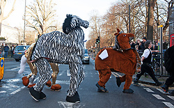 ©Licensed to London News Pictures 15/12/2019. <br /> Greenwich ,UK. The Pantomime Christmas horse race around Greenwich pubs in South East London took place this afternoon. Now in its 10th year the race had a Star Wars theme. Photo credit: Grant Falvey/LNP