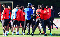 Eric Bailly hugs Anthony Martial of Manchester United during training - Mandatory by-line: Matt McNulty/JMP - 19/10/2016 - FOOTBALL - Manchester United - Training session ahead of Europa League game against Fenerbahce