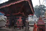 A small temple, forming a part of the  Pashupatinath Temple complex with Kama Sutra wood carvings.