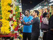 05 JUNE 2015 - KUALA LUMPUR, MALAYSIA: Shoppers look at flower garlands in the Little India section of Kuala Lumpur. The flower garlands are used in Hindu prayers and offerings.     PHOTO BY JACK KURTZ