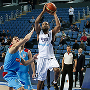 Efes Pilsen's Bootsy THORNTON (R)  during their Turkish Basketball league match Efes Pilsen between MP Trabzonspor at the Sinan Erdem Arena in Istanbul Turkey on Friday 11 March 2011. Photo by TURKPIX