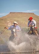 Gauchos on horseback cross river, Estancia Huechahue, Patagonia, Argentina, South America