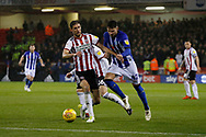 Sheffield Wednesday defender Matt Penney (42) goes pastSheffield United midfielder Chris Basham (6)  during the EFL Sky Bet Championship match between Sheffield United and Sheffield Wednesday at Bramall Lane, Sheffield, England on 9 November 2018.