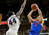 Florida guard Egor Koulechov (4) puts up a shot against Texas A&M forward Robert Williams (44) during the second half of an NCAA college basketball game Tuesday, Jan. 2, 2018, in College Station, Texas. (AP Photo/Sam Craft)