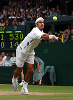 Roger Federer (Switzerland) in action during his Mens Singles Final victory over Mark Philippoussis (Australia) Wimbledon Tennis Championship, Day 13, 6/07/2003. Credit: Colorsport / Matthew Impey DIGITAL FILE ONLY