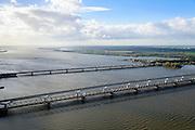 Nederland, Zuid-Holland, Gemeente Strijen, 23-10-2013; Moerdijkbruggen over het Hollandsch Diep. Van beneden naar boven: Spoorbrug Hollandsch Diep, HSL-brug, Verkeersbrug met autosnelweg A16.<br /> Moerdijk bridges over the Hollands Diep. From bottom to top: Railway bridge Hollands Diep, HSL bridge, road bridge A16 motorway.<br /> luchtfoto (toeslag op standard tarieven);<br /> aerial photo (additional fee required);<br /> copyright foto/photo Siebe Swart