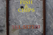 Emulsion paint smeared over window of fish and chip shop Top Nosh, a victim of the recession in West Street Bristol.