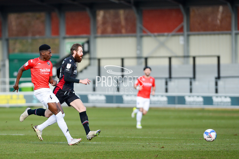 Scunthorpe United Kevin van Veen (10) Salford City Di'Shon Bernard (12) battles for possession during the EFL Sky Bet League 2 match between Salford City and Scunthorpe United at the Peninsula Stadium, Salford, United Kingdom on 6 March 2021.