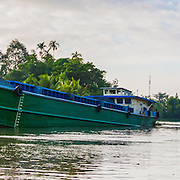CAPTION: Excessive boat traffic is one of the causes of erosion along the riverbanks. LOCATION: An Binh Ward, Can Tho, Vietnam. INDIVIDUAL(S) PHOTOGRAPHED: N/A.
