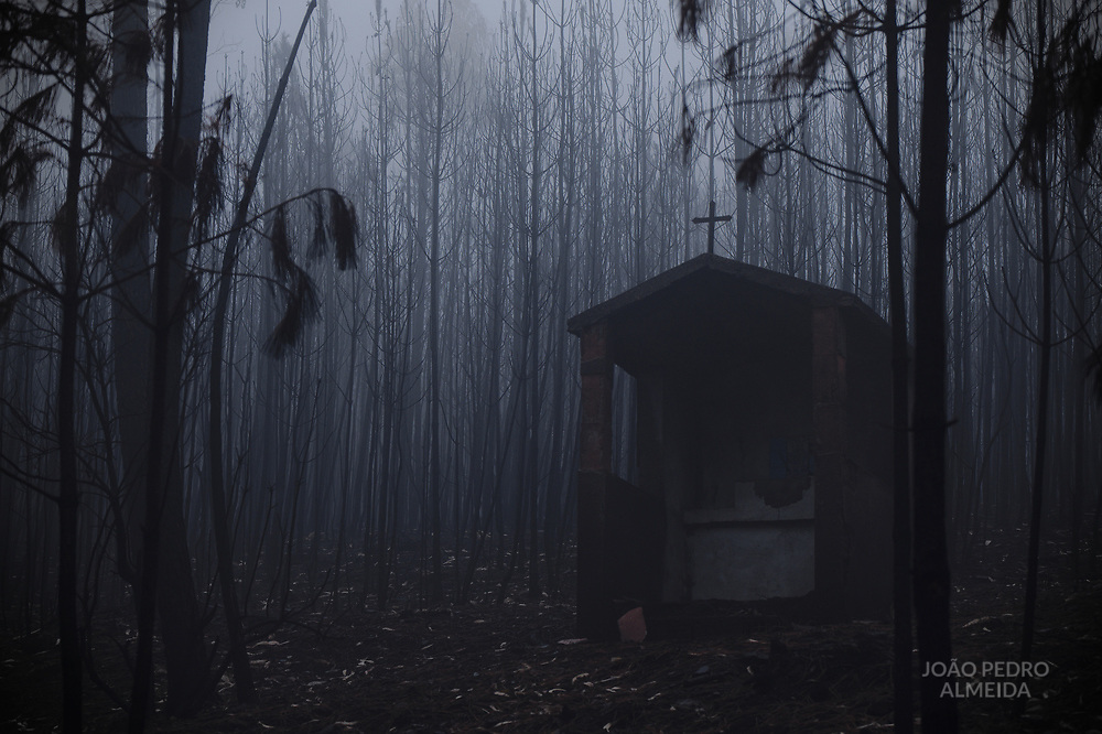 """""""Alminhas"""" are small shrines for the dead, often found in crossroads. This one was already abandoned and in decay when consummed by flames."""