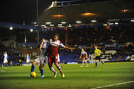 Birmingham City's  Paul Caddis (L) battles with Middlesbrough's Lucas Jutkiewitz during the Skybet football league championship match, Birmingham city v Middlesbrough at St.Andrew's in Birmingham, England on Sat 7th Dec 2013. pic by Jeff Thomas/Andrew Orchard sports photography.