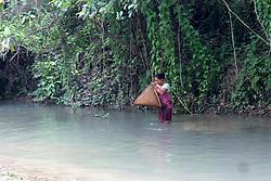 April 27, 2018 - Nikashi, Assam, India - Tribal women fishing in a river with traditional fishing instrument 'Jakoi' (Credit Image: © David Talukdar/Pacific Press via ZUMA Wire)