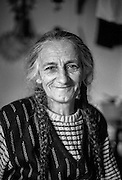 """""""Nana"""" (Bosnian: Grandmother), a female refugee from Bosnia sitting for a portrait at the Varazdin refugee camp in Croatia in the winter of 1992."""