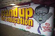 Graffiti carricature of Minister for Education Michael Gove MP at the Undercroft, skateboard area at the South Bank. London, UK. The slogan being painted reads Stand up for education.