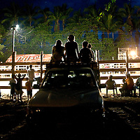 Ticos watch a rodeo in the beachside town of Dominical, Costa Rica on April 26, 2009.  (Photo/William Byrne Drumm)