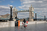 Tower Bridge is eerily quiet and silent on empty streets with very few people or tourists as lockdown continues and people observe the stay at home message in the capital on 11th May 2020 in London, England, United Kingdom. Coronavirus or Covid-19 is a new respiratory illness that has not previously been seen in humans. While much or Europe has been placed into lockdown, the UK government has now announced a slight relaxation of the stringent rules as part of their long term strategy, and in particular social distancing.