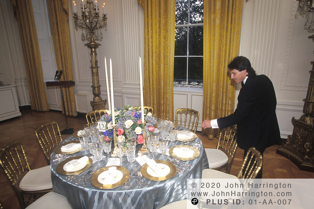 THE WHITE HOUSE PENMAN PLACES NAME PLACARDS AT EACH GUESTS PLACE WHICH HE AND HIS STAFF HAND STROKED EACH NAME, PREPARED FOR THE STATE DINNER IN THE EAST ROOM