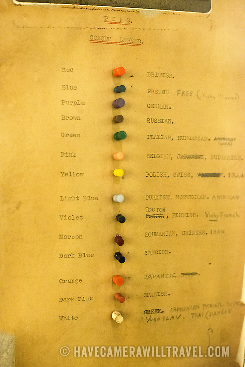 A key showing which colored pins mean what on the large wall maps in the Map Room at the Churchill War Rooms in London. The museum, one of five branches of the Imerial War Museums, preserves the World War II underground command bunker used by British Prime Minister Winston Churchill. Its cramped quarters were constructed from a converting a storage basement in the Treasury Building in Whitehall, London. Being underground, and under an unusually sturdy building, the Cabinet War Rooms were afforded some protection from the bombs falling above during the Blitz.