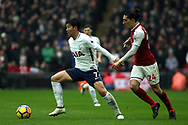 Hector Bellerin of Arsenal (R) in action with Son Heung-min of Tottenham Hotspur (L) Premier league match, Tottenham Hotspur v Arsenal at Wembley Stadium in London on Saturday 10th February 2018.<br /> pic by Steffan Bowen, Andrew Orchard sports photography.