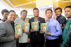 February 5, 2018 - Dhaka, Bangladesh - Bangladeshi Cricketer Shakib Al Hasan (C) hold up with others guest his written a book name is ''Halum'' at Parl Publications stall in Ekushey Book Fair in Dhaka, Bangladesh. On February 5, 2018. (Credit Image: © Str/NurPhoto via ZUMA Press)