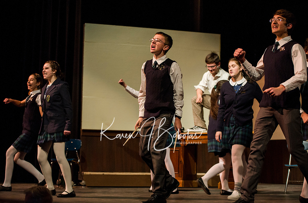 """""""Freddy"""" Jesse Powers rocks out with his classmates during dress rehearsal for School of Rock at Gilford High School on Tuesday evening.  Karen Bobotas/for the Laconia Daily Sun)"""
