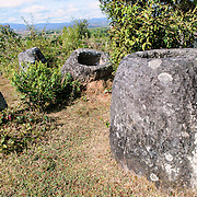 Stone jars at Site 3 of the Plain of Jars in north-central Laos. Much remains unknown about the age and purpose of the thousands of stone jars clustered in the region. Most accounts date them to at least a couple of thousand years ago and theories have been put forward that they were used in burial rituals.